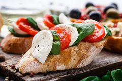 Bruschetta with tomatoes, mozzarella and basil Royalty Free Stock Photo
