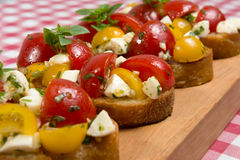 Bruschetta with tomatoes and mozzarella cheese Royalty Free Stock Photography