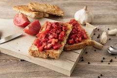 Bruschetta with tomatoes on rustic wood background Stock Image