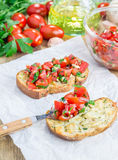 Bruschetta with tomatoes on toasted garlic cheese bread Royalty Free Stock Image