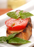 Bruschetta topped with fresh tomato and basil Stock Photos