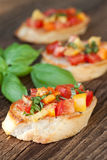 Bruschetta topped with tomato, paprika, garlic Royalty Free Stock Photography