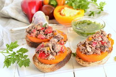 Bruschetta with tuna, tomatoes and sweet peppers with sauce Royalty Free Stock Images