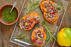 Bruschetta with tuna, tomatoes and sweet peppers with sauce Stock Photo