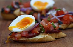 Bruschetta with vegetables and egg stock image