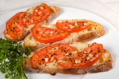 Bruschetta on white plate. At shallow depth of field Royalty Free Stock Photography