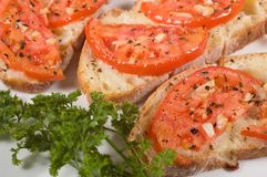 Bruschetta on white plate Royalty Free Stock Images