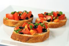 Bruschetta on white plate closeup Stock Photos