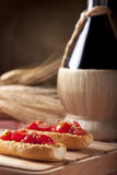 Bruschetta with Wine Flask Royalty Free Stock Photos