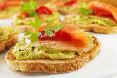Free Bruschetta With Guacamole, Smoked Salmon Royalty Free Stock Photos - 25835258