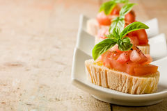 Bruschetta With Tomatoes And Basil Royalty Free Stock Photo