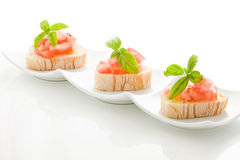 Bruschetta With Tomatoes And Basil Isolated Royalty Free Stock Photos