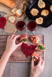Bruschetta. Woman is cooking romantic dinner. Top view. Valentine Day. Love. Stock Photo