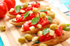 Bruschetta on wooden board Royalty Free Stock Image