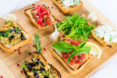 Bruschetta on wooden plate Royalty Free Stock Images
