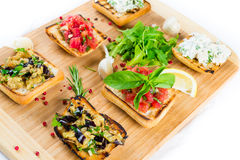 Bruschetta on wooden plate Royalty Free Stock Image