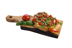 Bruschetta on wooden plate isolated Royalty Free Stock Photography