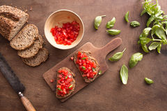 Bruschetta on wooden table Royalty Free Stock Images