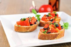 Bruschetta on wooden table and white plate with chilioil 2 Royalty Free Stock Image