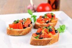 Bruschetta on wooden table and white plate closeup Royalty Free Stock Photos