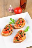 Bruschetta on wooden table and white plate from the top 2 Stock Image