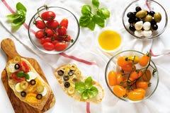 Bruschetta with yellow and red cherry tomatoes, Stock Image