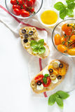 Bruschetta with yellow and red cherry tomatoes, Royalty Free Stock Photos
