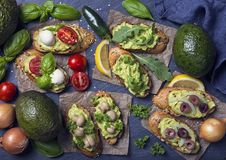 Bruschettas with bread and guacamole. Bruschettas with rye bread and guacamole stock photography