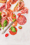 Bruschettas with Italian ham, sausage and basil pesto Royalty Free Stock Image