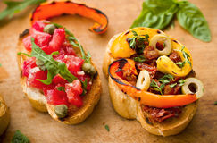 Bruschettas with mozzarella, vegetables and herbs  Stock Photo