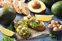Bruschettas with rye bread and guacamole. Bruschettas with rye bread, guacamole and champignons royalty free stock photography