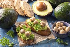 Bruschettas with rye bread and guacamole. Bruschettas with rye bread, guacamole and champignons stock photography