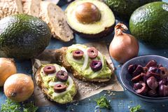 Bruschettas with rye bread and guacamole. Bruschettas with rye bread, guacamole and olives stock images