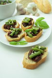 Bruschettas with sundried tomato and green bean Royalty Free Stock Photos