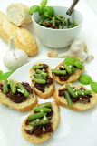 Bruschettas with sundried tomato and green bean Stock Images