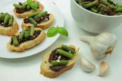 Bruschettas with sundried tomato and green bean Royalty Free Stock Images
