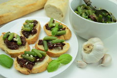 Bruschettas with sundried tomato and green bean Stock Image