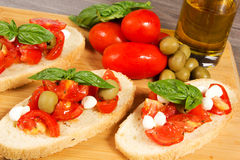 Bruschette. With juicy tomatoes on fresh bread, pesto as topping Royalty Free Stock Photography