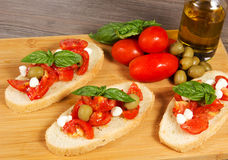 Bruschette. With juicy tomatoes on fresh bread, pesto as topping Royalty Free Stock Photos
