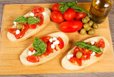 Bruschette. With juicy tomatoes on fresh bread, pesto as topping Royalty Free Stock Image