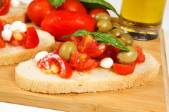 Bruschette. With juicy tomatoes on fresh bread, pesto as topping Royalty Free Stock Photo