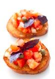 Bruschette avec des tomates et des oignons photo stock