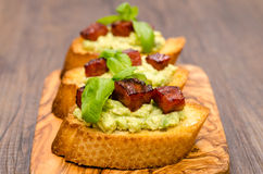 Bruschette with avocado, chorizo sausage and basil Stock Images