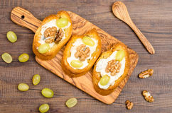Bruschette with cheese on a wooden board Stock Photography