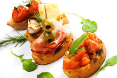 Bruschette with prosciutto and olive stock photos