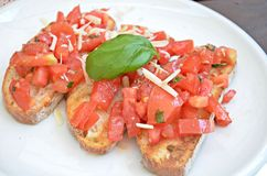 Bruschette with tomato, cheese and basil. Apetizer bruschette with tomato, cheese and basil Royalty Free Stock Photo