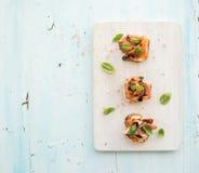 Bruschettes avec le Prosciutto, melon rôti, doux Photographie stock
