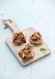 Bruschettes avec le Prosciutto, melon rôti, doux Photos stock