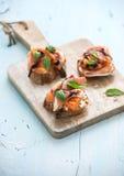 Bruschettes avec le Prosciutto, melon rôti, doux Image libre de droits