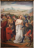 Bruselas - Jesus Stripped de su ropa. Pintura de St. Nicolás e iglesia de Jean s a partir. del centavo el 19. Imagen de archivo libre de regalías